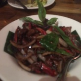 Chili Lamb (not available mild) stir fried lamb with dried and fresh chili, onion and basil, comes medium spicy, or spicier