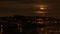 Moon hanging behind the clouds in Sausalito