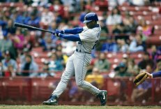 CIRCA 1990's: Outfielder Ken Griffey Jr. #24 of the Seattle Mariners swings and watches the flight of his ball during a early circa 1990's Major League Baseball game. Griffey played for the Mariners from 1989-99. (Photo by Focus on Sport/Getty Images)