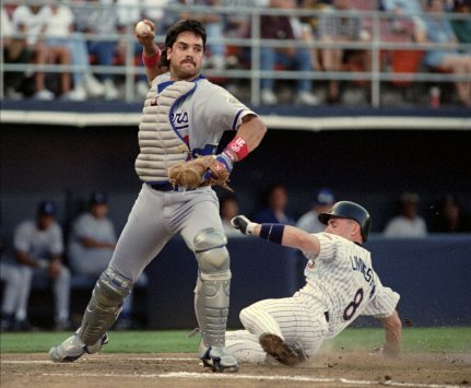 Los Angeles Dodgers' catcher Mike Piazza fires a throw to first after stepping on homeplate for a force out and then completing a double play as San Diego Padres' Scott Livingstone slides in during the first inning of the Dodgers game against the San Diego Padres Wednesday July 3, 1996 in San Diego. Piazza had fielded a swinging bunt with the bases loaded and completed the double play to end a Padres' threat. (AP Photo/Lenny Ignelzi)